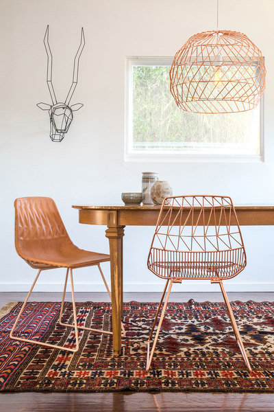 """Galvanized iron woven wire chairs, pendant lighting and a gazelle """"trophy"""" all designed by Bend Goods"""