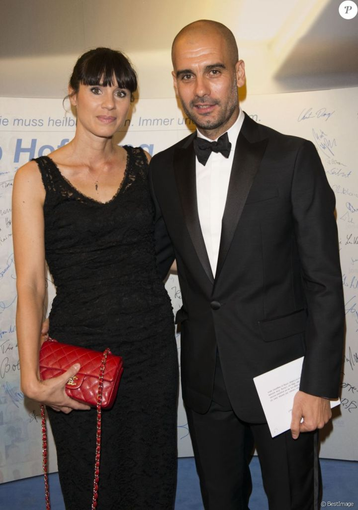 "Pep Guardiola and his wife Christina Serra at the ""Care-for-Rare Science Awards 2014"" awards ceremony in Munich on 13 November 2014"