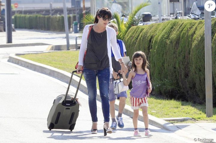 Pep Guardiola arrives in Barcelona with his wife Cristina and his children, Maria, Marius and Valentina on 1 June 2014.