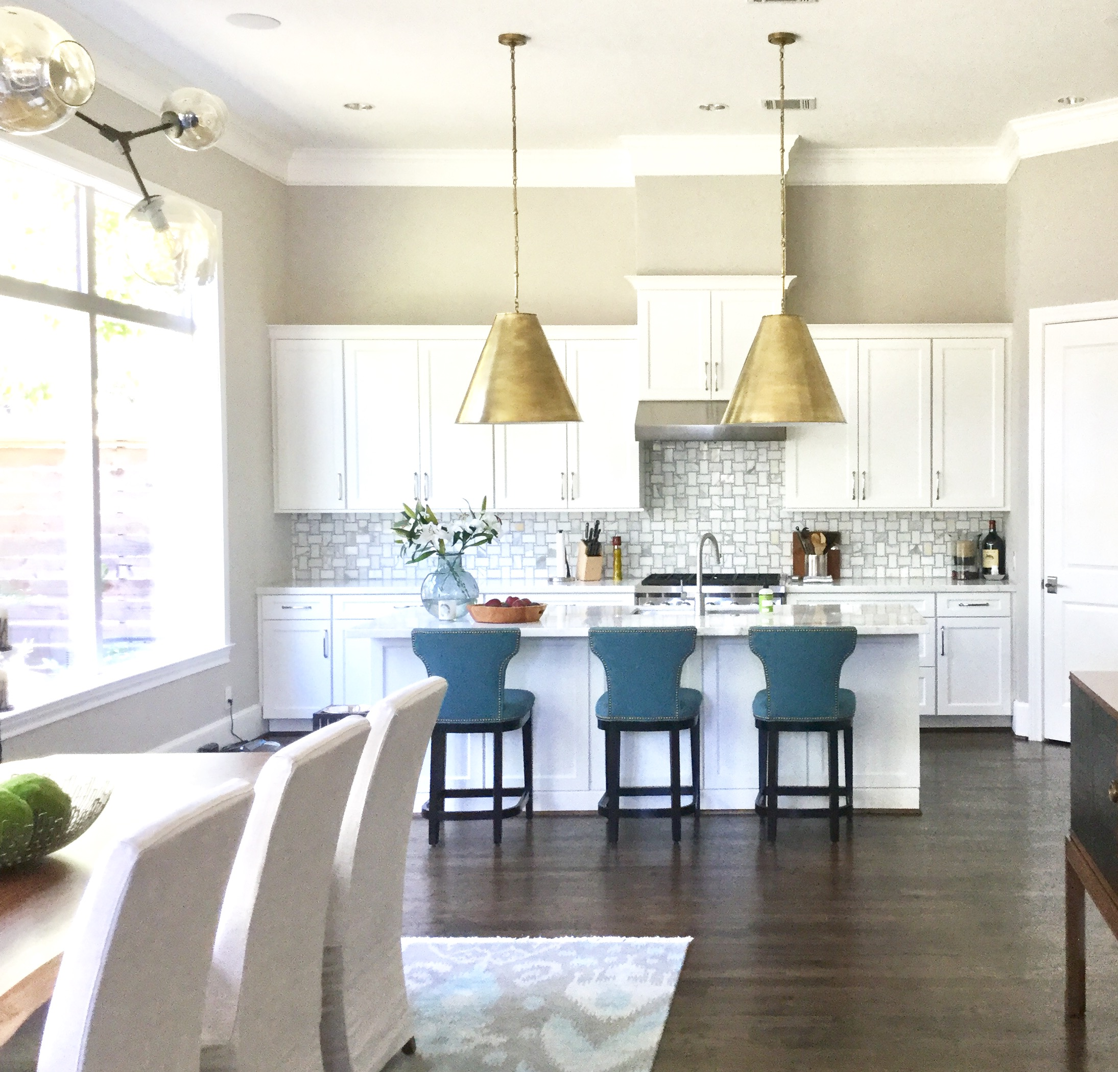 kitchen island pendant lights commercial floor cleaning 7 considerations for lighting selection large brass cone shaped fixtures carla aston designer
