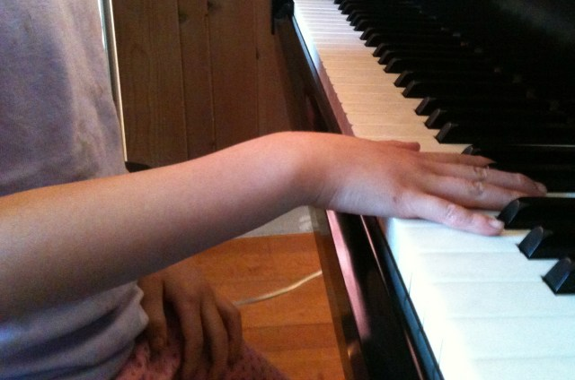 5-year-old student's hand position before the Ladybug.