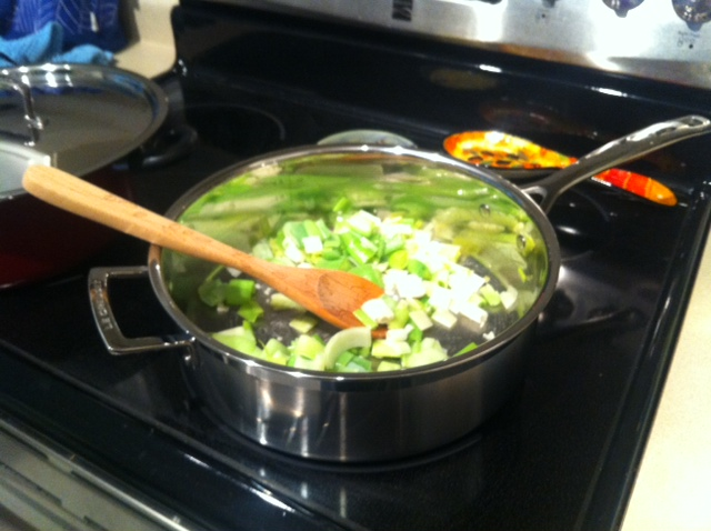 Sautéing leeks for the Potato and Leek Gratin.