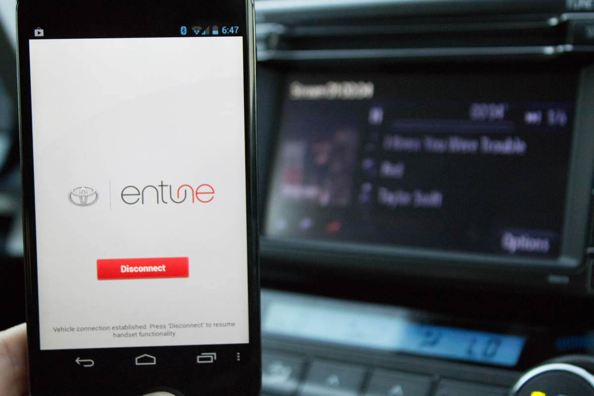 The required Entune app running on a Nexus 4. In back you can see Pandora running on the RAV4's Entune system. The app acts as a gateway, providing the data the Entune apps need.