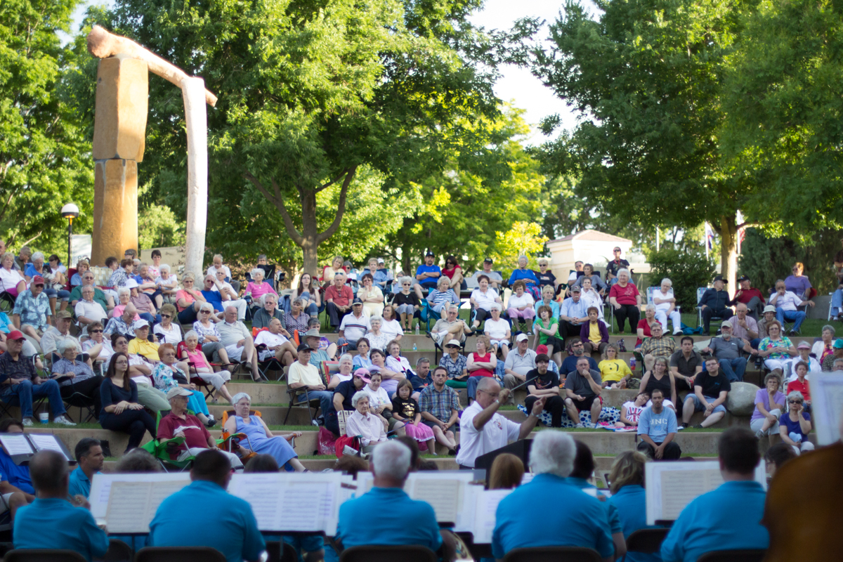Conductor Mark Emery leads the band in front of 100 people at the Wells Fargo Amphitheater at PCC.