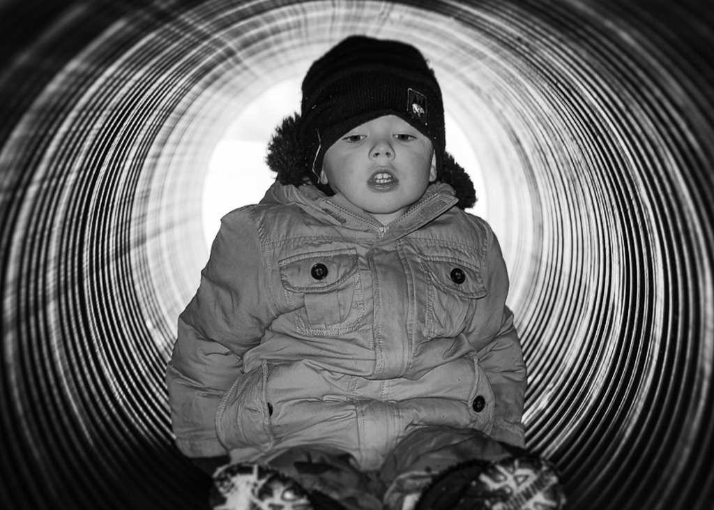 Patrick in a Tunnel I chose this photo for a couple different reasons. The first being, that it is of my son having fun at a local maple syrup festival. The second is because I was reminded of how quick you need to act in certain photo situations. At the last second, I used the popup flash to illuminate him. Half a second later and I would have missed the shot.