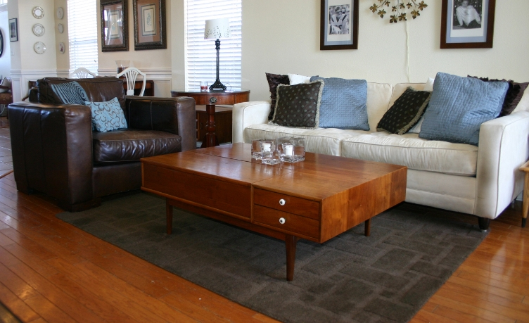 correct area rug size for living room midcentury modern proper sizing a before and after beckwith s rugs are an important element in my decor primarily because over the years i have removed every stitch of carpet house except master