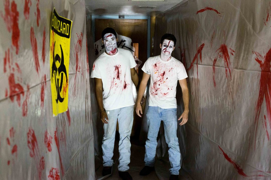 A couple of zombie brothers practice their technique within the haunted house