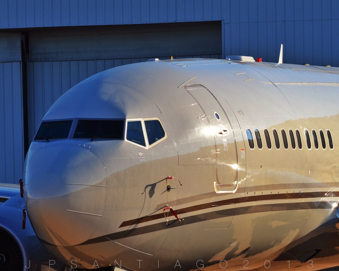 Here's something you don't see often- a Boeing BBJ with a main deck cargo door- basically a heavy gross weight 737-700C; slap some Navy markings on this bird and you'd have yourself a C-40A Clipper.  Boeing had announced the Combi BBJ (what they call the BBJC) back in 2007, but this is the first one I've seen. They're pretty rare, there can't be more than a small handful worldwide.