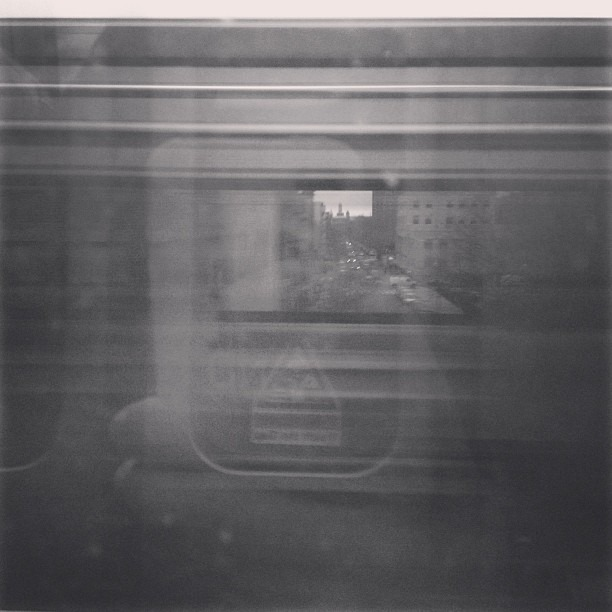 Shot through a passing train in Harlem. The best part about it is that my iPhone matches the adjacent train's exit door so you can't tell which is which. #metronorthdiaries (at 115 Street)