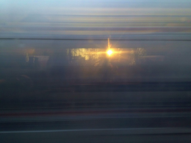 The Sun Through a Passing Train on Flickr.