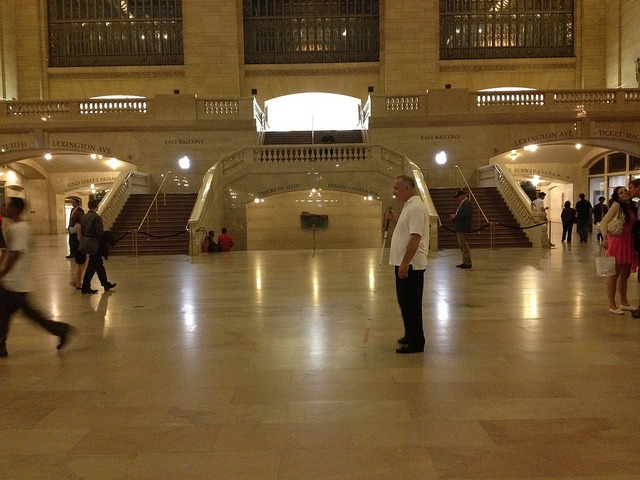 Hope for a generation. on Flickr. This blind man was standing in the middle of Grand Central during the Obama Speech last night. The Apple store logos shined in the background. I couldn't help but feel the pertinacity of continued innovation. You don't have to see the world to feel it.