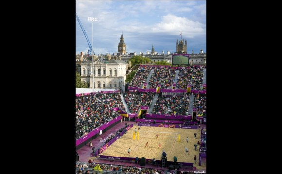 Athletes take the foreground while the London landmarks shine.   London.