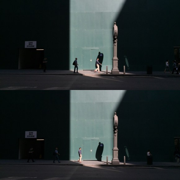 New Yorkers make their way through a beam of light this morning off 5th Avenue.
