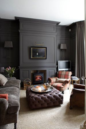 living rooms with dark gray walls nautical style room 10 spaces that will make you rethink those white sr gambrel wood paneled
