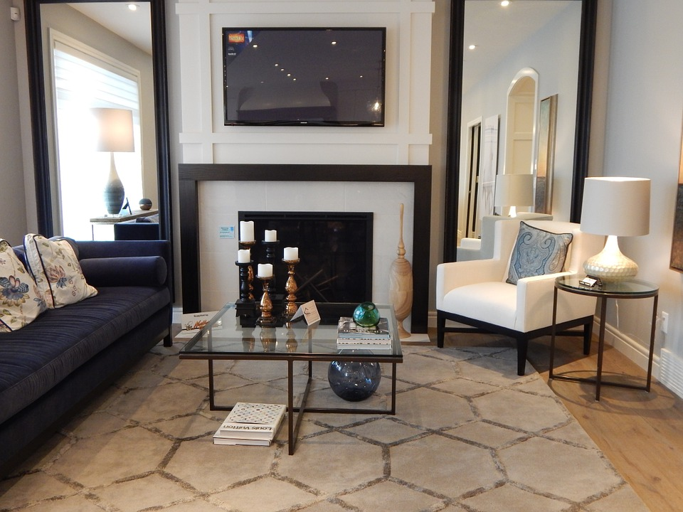 decorating ideas to make a small living room look bigger furniture arrangement for long narrow 7 home staging tricks huge team ramstead