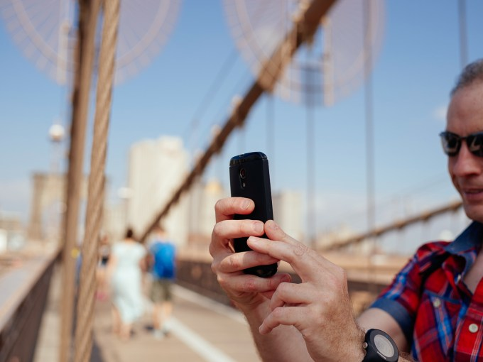 Man taking photo with mobile phone