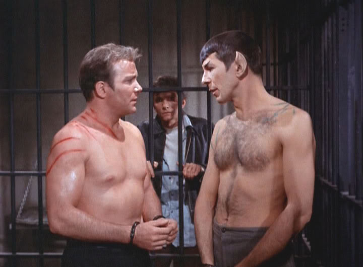 Kirk and Spock, missing shirts.