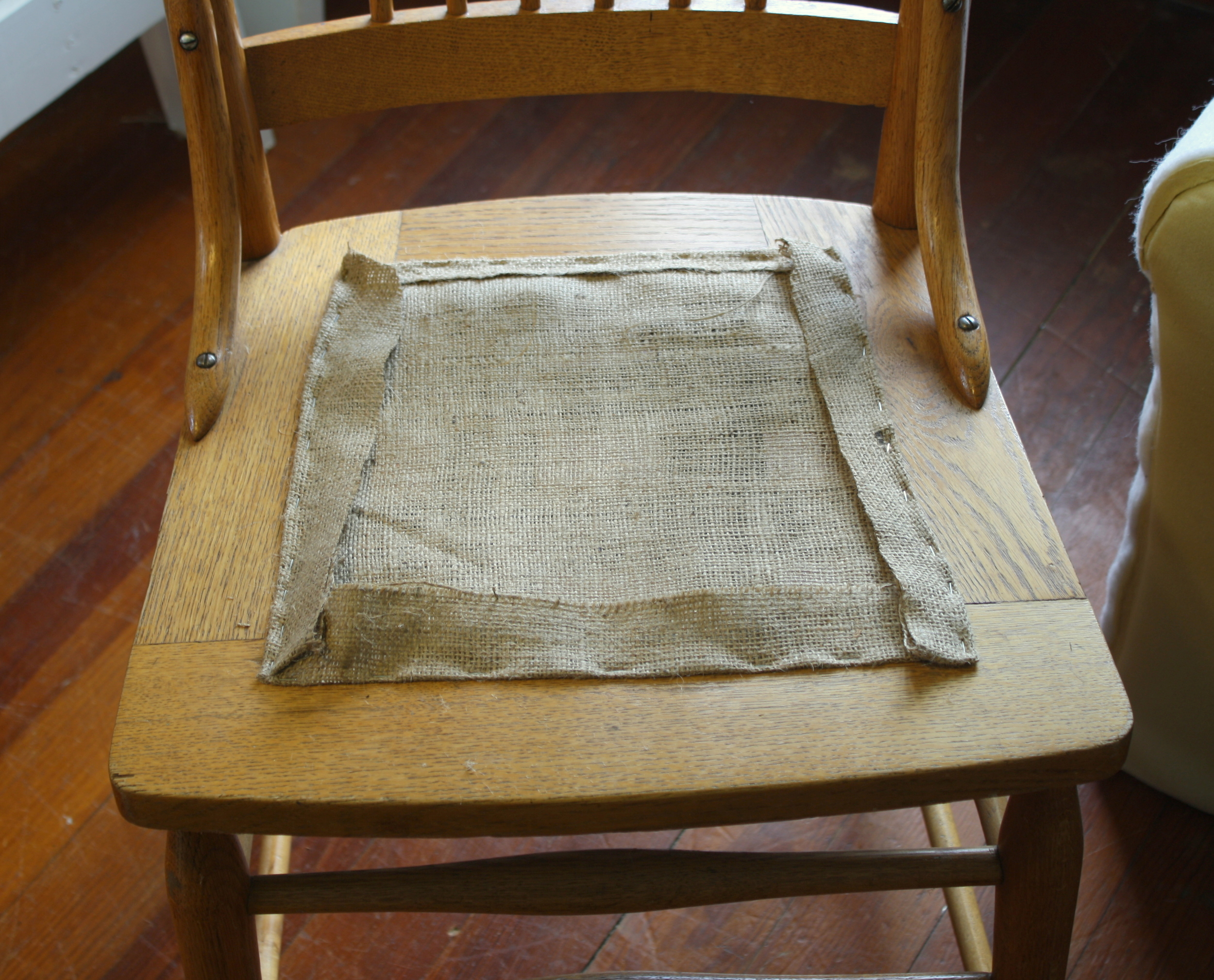 how to replace cane back chair with fabric boone high upholstery 101 broken caning a padded seat good bones there are specific tools available stretch this kind of webbing but you can also use pliers or strong arm staple down the vertical pieces
