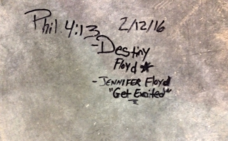 One of the signatures on the church foundation floor