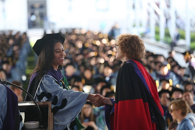Dean Gillian Lester conferring degree to Lilybelle.