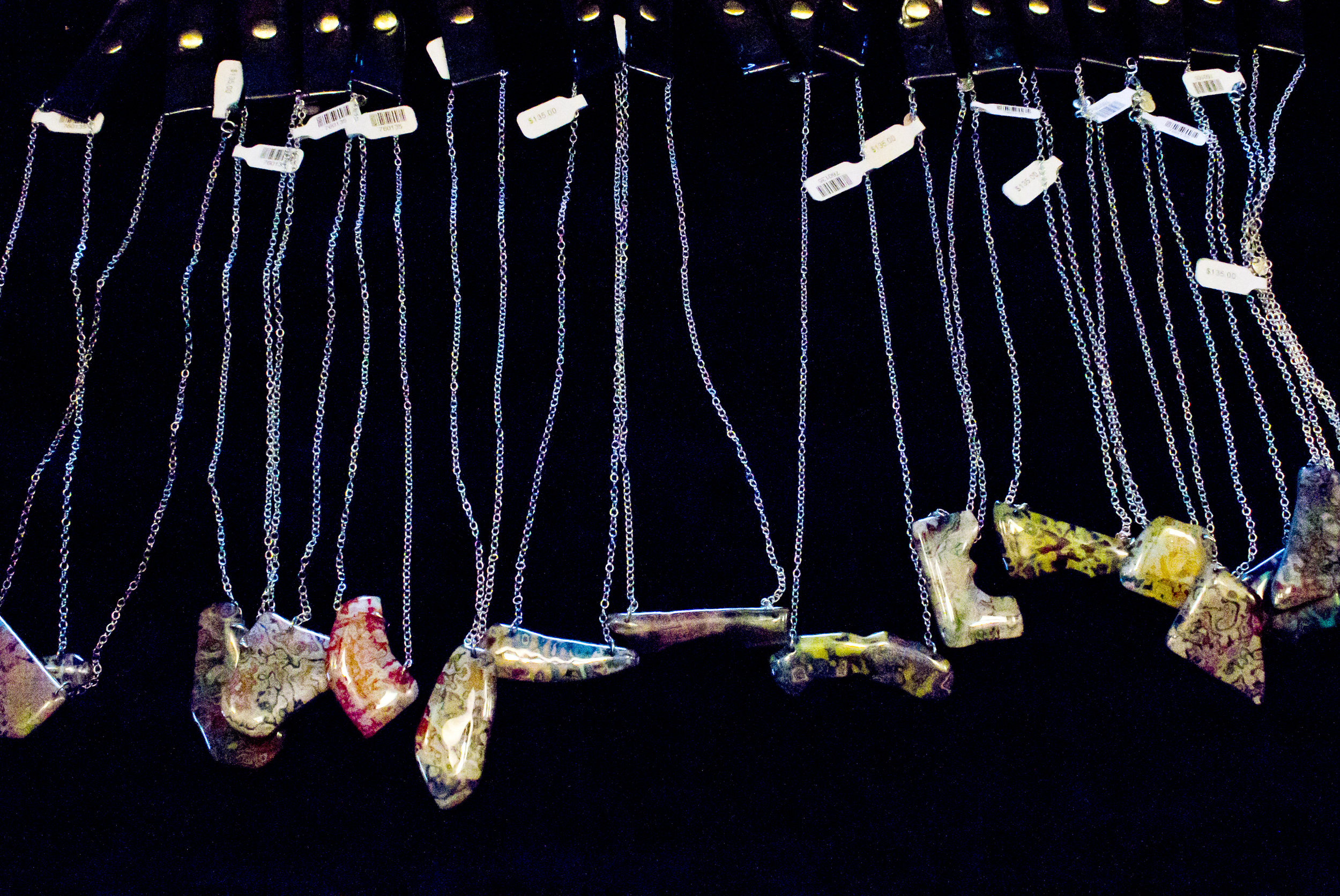 Rebel Nell pendants fashioned out of re-purposed graffiti shards.  Photo by Amy Cooper