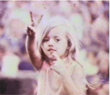 Child gives peace sign during Goose Lake International Music Festival. Photo: Goose LakeFilm Still.