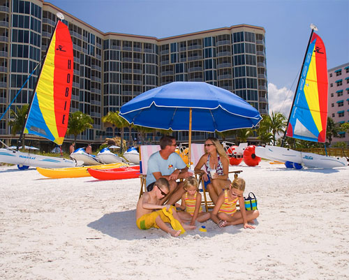 beach chairs and umbrella baby swing chair argos ireland rentals fort myers holiday water umbrellas