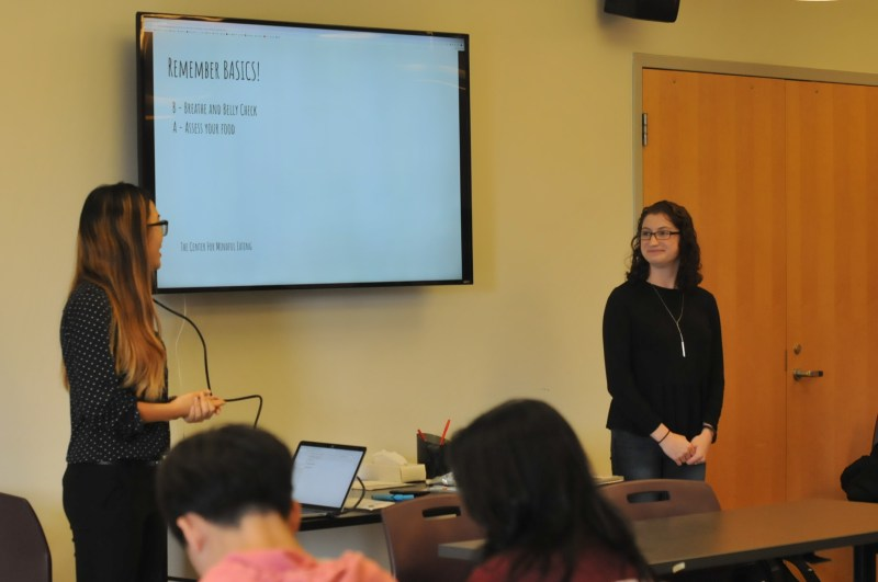 UConn students in the allied health coordinated dietetics program lead a talk about mindful eating in the women's center. (Photo by Hanaisha Lewis/The Daily Campus)