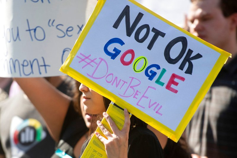 FILE- In this Nov. 1, 2018, file photo workers protest against Google's handling of sexual misconduct allegations at the company's Mountain View, Calif., headquarters. Google is promising to be more forceful and open about its handling of sexual misconduct cases, a week after high-paid engineers and others walked out in protest over its male-dominated culture. CEO Sundar Pichai spelled out the concessions in an email sent Thursday, Nov. 8, to Google employees. (AP Photo/Noah Berger, File)