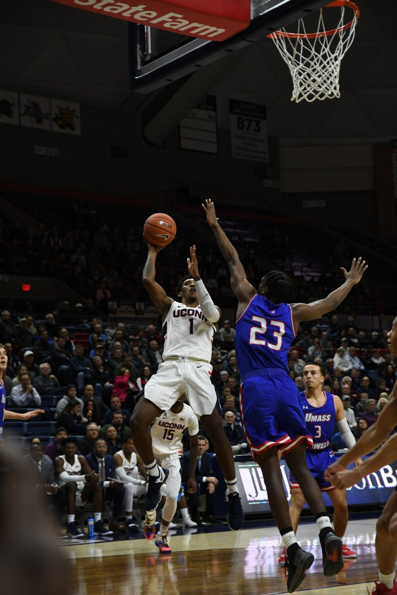 Christian Vital hangs in the air during the Huskies 97-75 win. (Nicholas Hampton/ The Daily Campus)