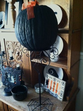 Black pumpkin on stand