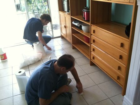 Boys cleaning floor