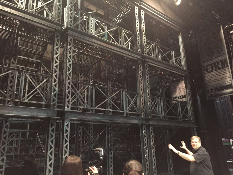 Production Stage Manager Jeff Norman explaining how the towers work. photo Amy Hohneker