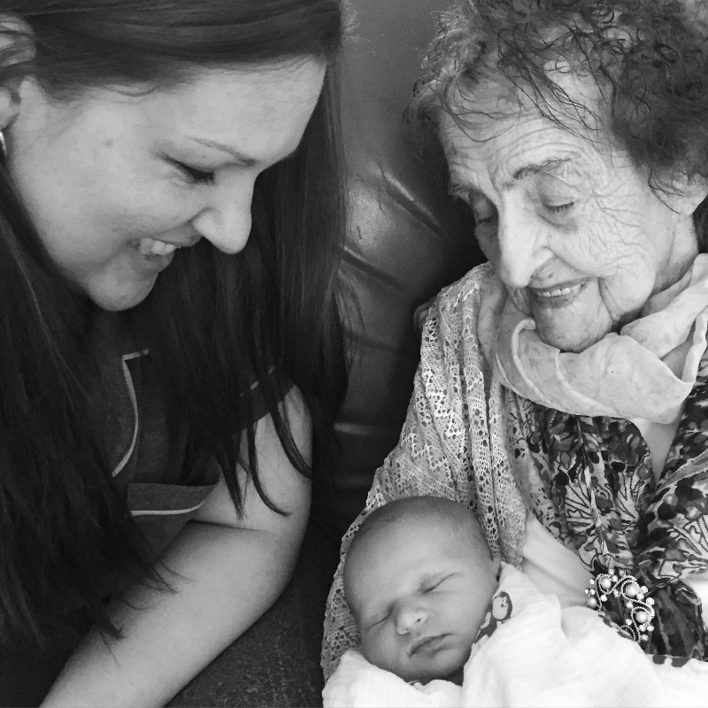 Amy introduces Sebastian (1 week old)  to his great grandmother, Luza (102).