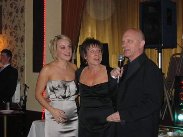 My parents and I at my 21st birthday party. God I was so skinny! I had a collar bone!