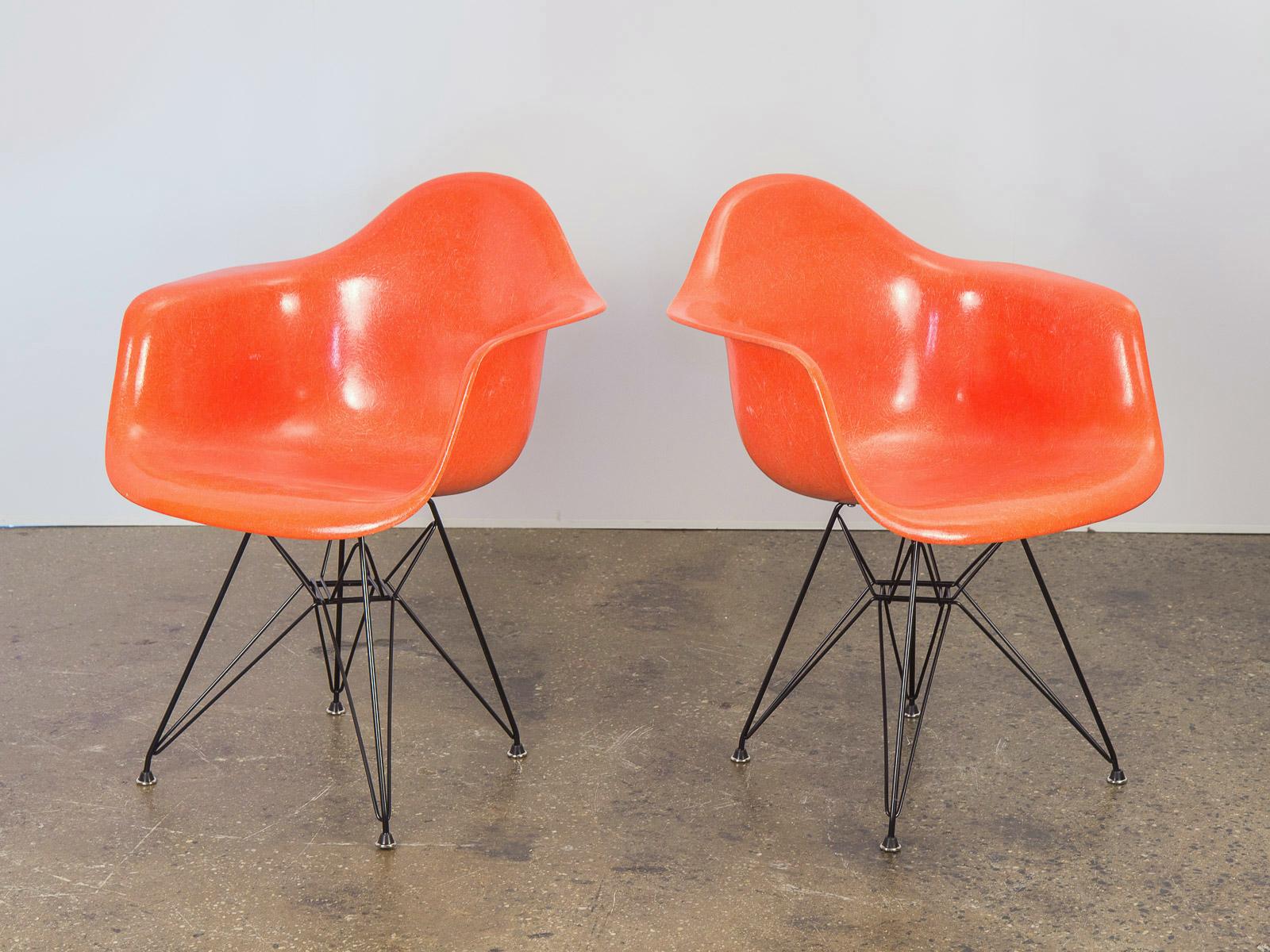 eames arm chair hanging egg kmart pair of orange armchair shells oam open air modern fiberglass armchairs for herman miller on black eiffel base 1 jpg