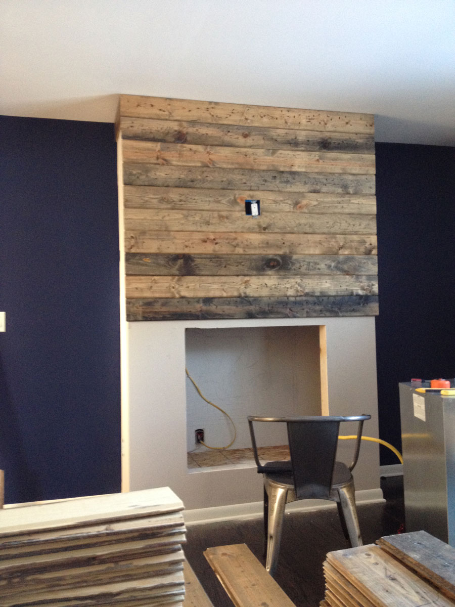 How to create a DIY reclaimed wood fireplace surround for less than 100  Grand Rapids Interior