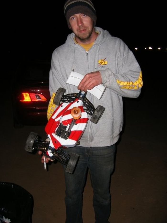 Very tired adult me with a toy car at the Nitro Challenge in Arizona some years back. I had no sponsors when I arrived in America so it was a very expensive toy car.