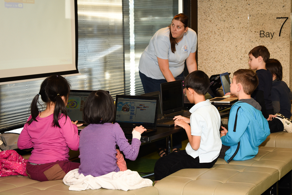 Year 2-3 students learning to programme with Scratch by building their own computer game.