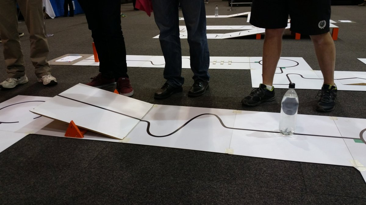 Robocup Junior Queensland 2016 - Soccer Challenge: straight lines, water tower (water bottle) to avoid, seesaw and curved lines for the robot to navigate