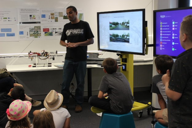 Children learning about how robots are learning to see and navigate their environment using machine learning techniques.
