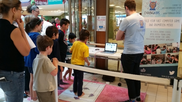 Students eager to bust some moves on the Dance Dance Revolution game they created using Scratch and Makey Makey