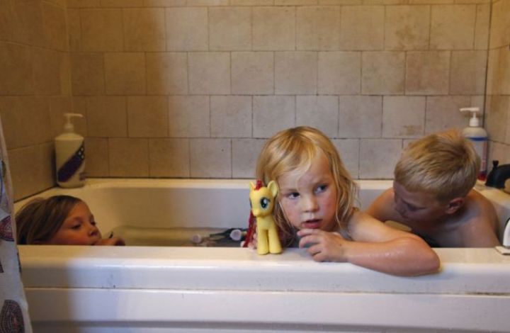 Markegard siblings Quill (left), Quince and Larry take their weekly bath together to save water at their family home in Half Moon Bay. The family runs a small ranch and is trying to get by amid a severe water shortage.  Photo: Leah Millis / The Chronicle
