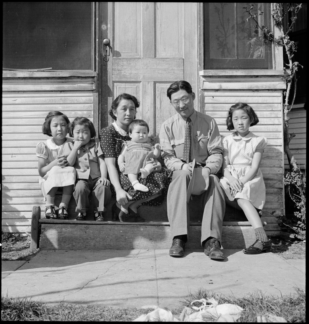 Mountain View, California. Henry Mitarai, age 36, successful large-scale farm operator with his family on the steps of their ranch home, about six weeks before evacuation. This family, along with others of Japanese ancestry, will spend the duration at War Relocation Authority centers.
