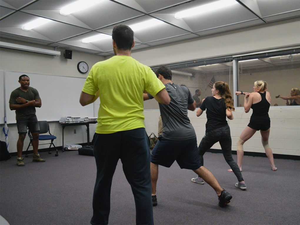 Pandit Mami, left, teaches Krav Maga, an Israeli form of self-defense, to members of Knights for Israel in UCF's Engineering I building on Wednesday, Sept. 14, 2016. Mami, originally from Sierra Leone, has taught seminars at more than 25 different schools.