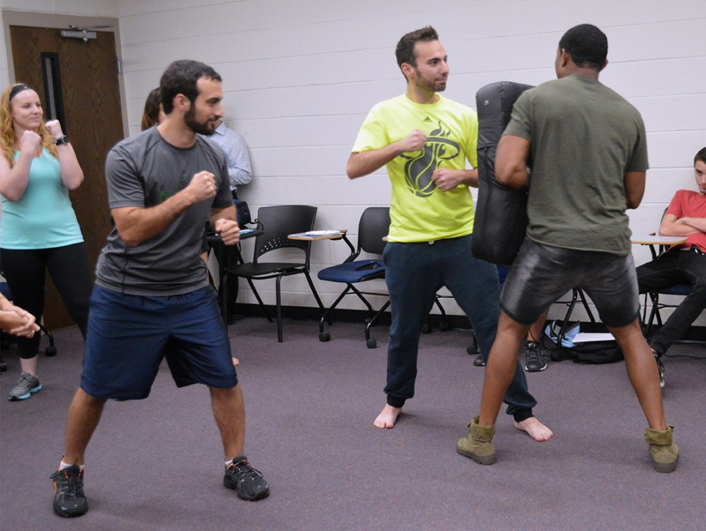UCF senior Ben Suster,center, takes a stab at the punching method taught by instructor Pandit Mami during the Krav Maga self-defense lesson in UCF's Engineering I building on Wednesday, Sept. 14, 2016. Krav Maga is used by the Israel Defense Forces and combines boxing, wrestling and other fight training.