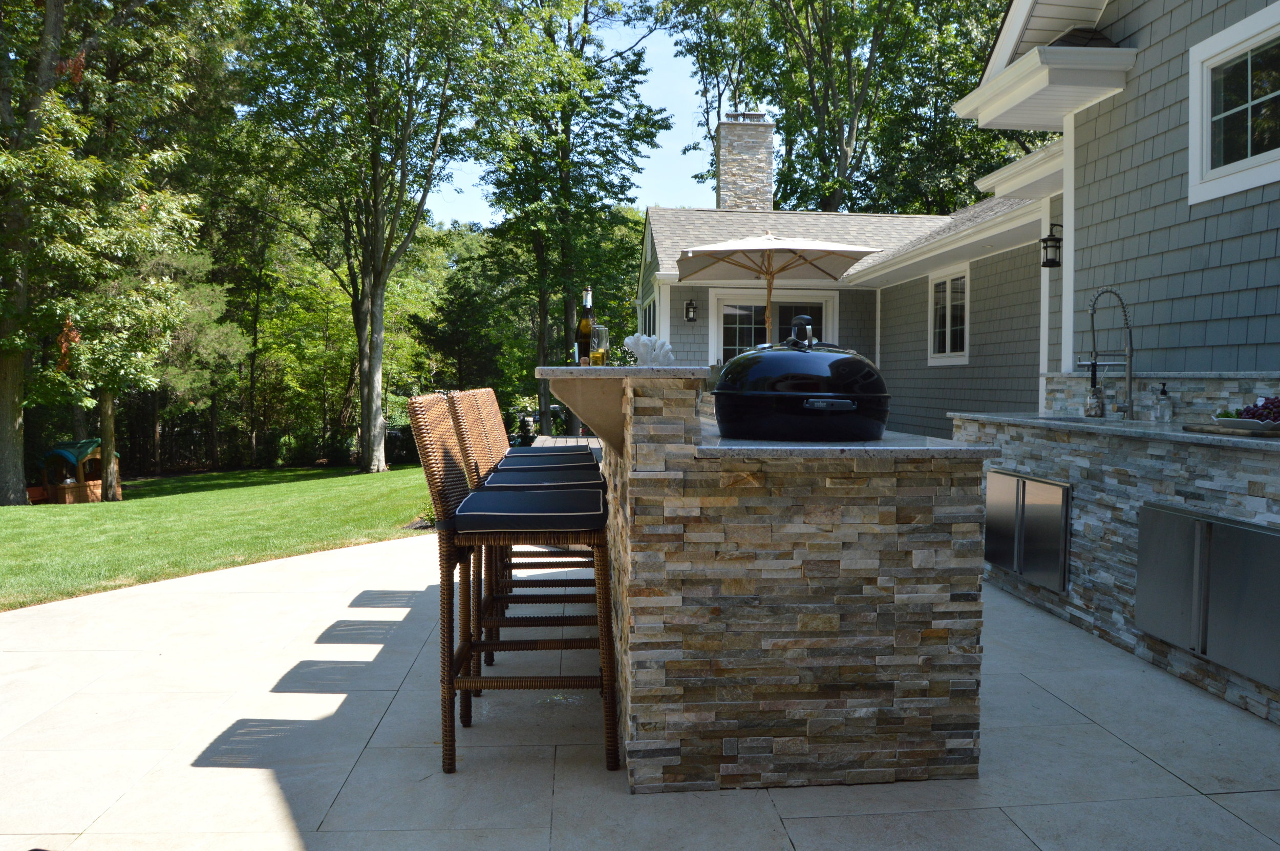 outdoor kitchen bar glass table set for kitchens in plainview ny long island above all masonry and with seating natural stone
