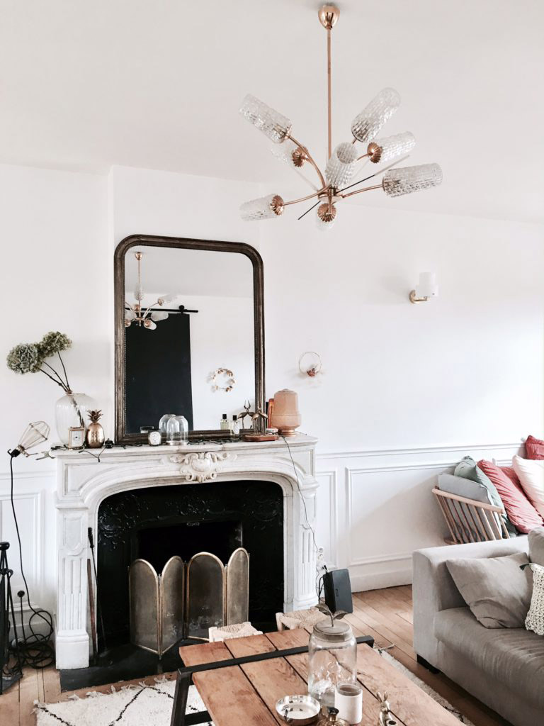 living room fireplaces brass table lamps for covering up and a update eliza kern design jarrard s apartment we put furniture in front of the fireplace but filled it with art candles since you can still see from around