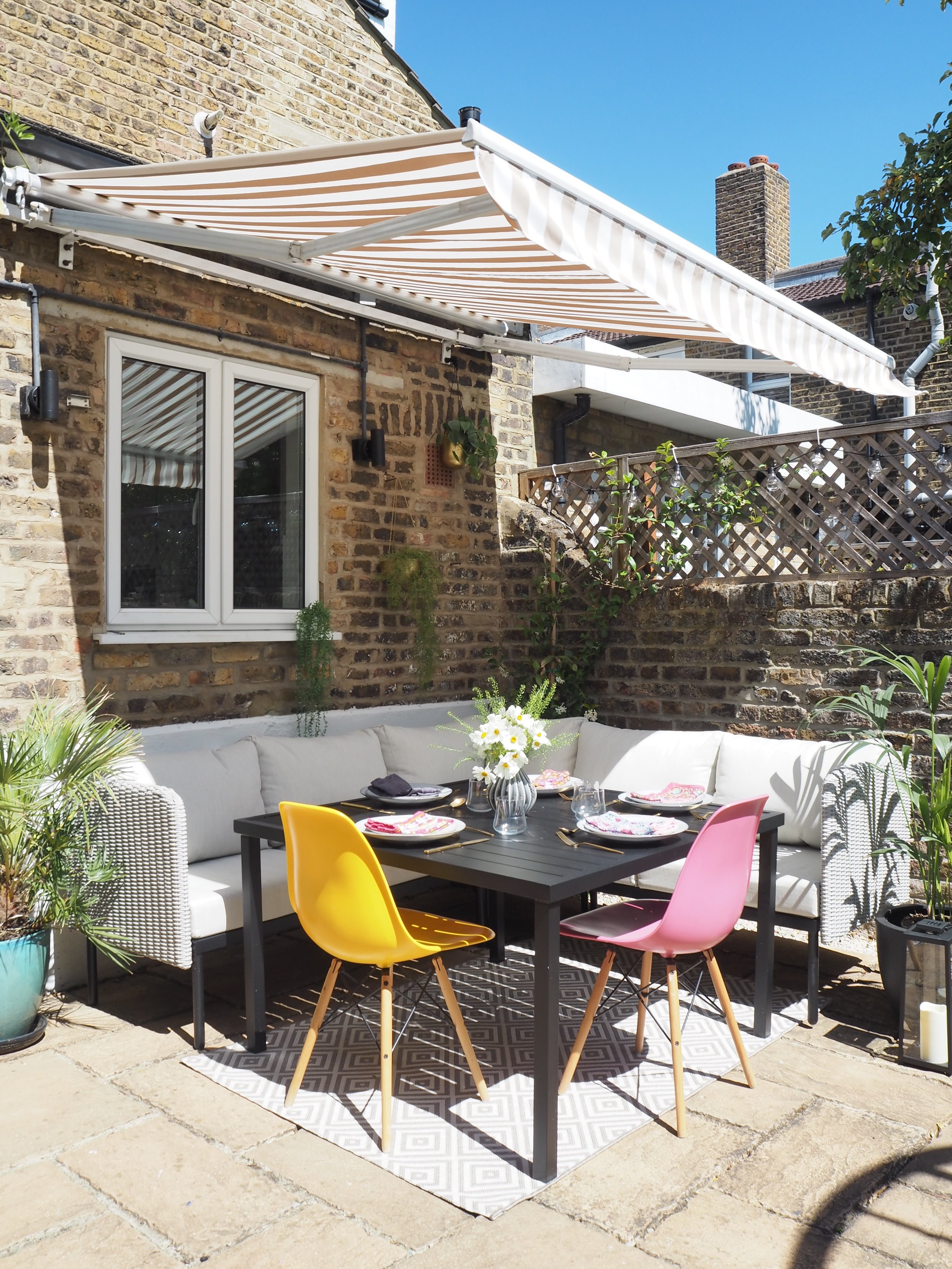 al fresco st tropez hanging chair and cushion wayfair heavy duty kitchen chairs how i transformed our scruffy patio into a gorgeous dining area