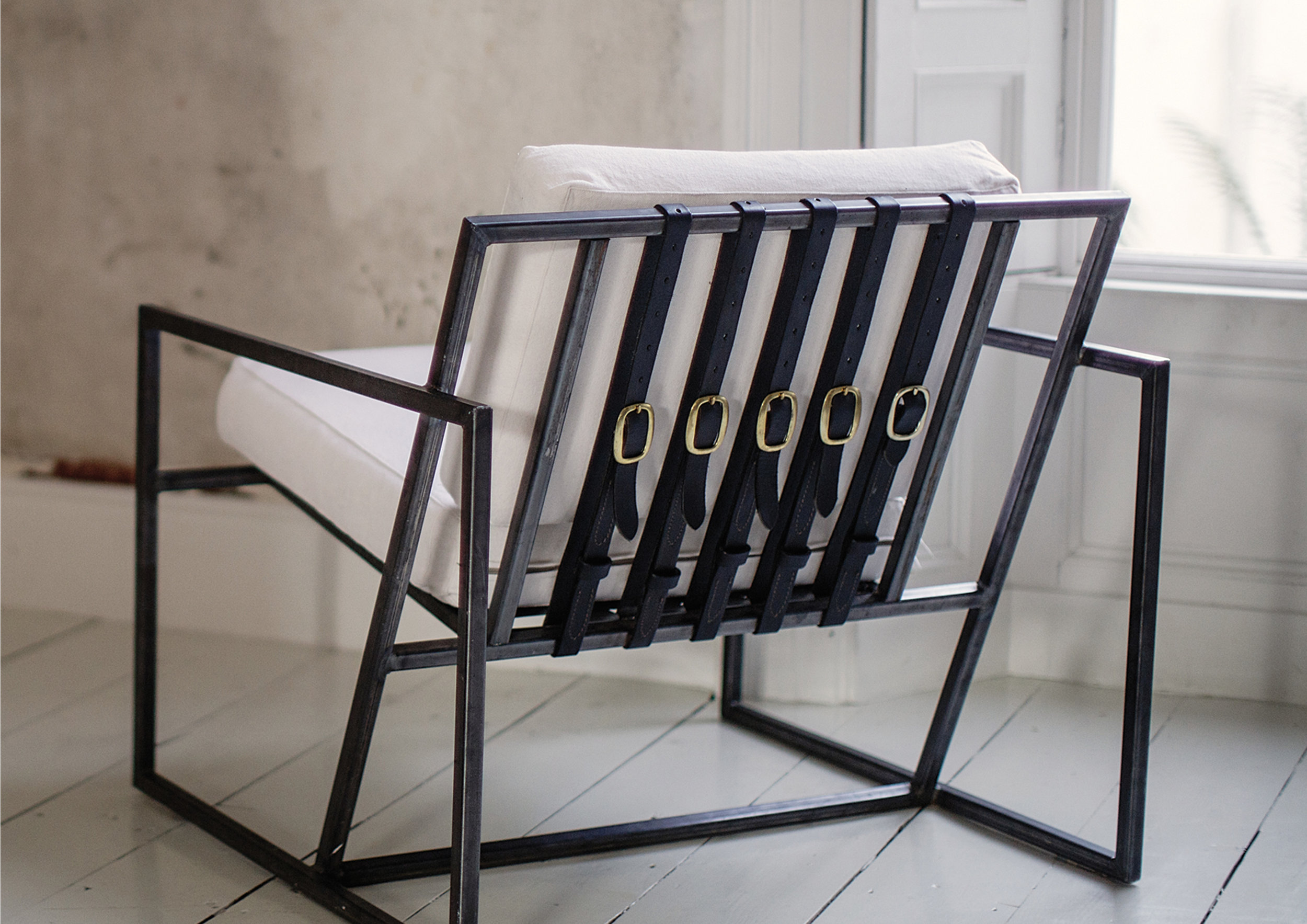 modern steel chair design cynthia rowley nailhead chairs and leather elements of action our simple elegant take on the classic arm straps frame is a versatile piece occasional furniture adaptable to any room